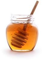 Öffnen Sie das Glas Honig